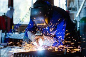 depositphotos_82456476-stock-photo-welder-welding-metal-in-workshop